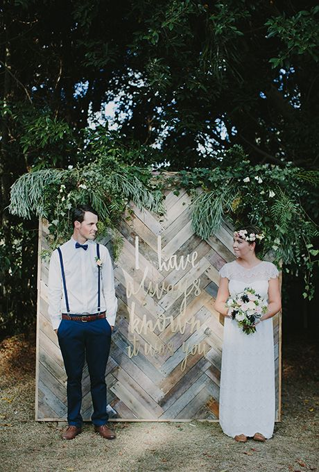 Brides.com: . Ready to get crafty? Boho couples will love this unique chevron wooden ceremony backdrop composed of re-claimed wood panels and gold laser-cut lettering.