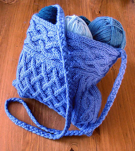 Free Knitting Pattern for Quinn Cabled Bag - This 9 inch square bag features a cable band, cable body, and long braided i-cord strap. Designed by CogKnition. Worsted yarn,