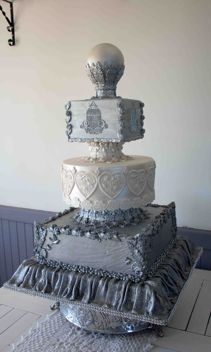 """Victoria"" - champagne & silver Approximately 45cm wide by 60cm high   With this cake I wanted to showcase the use of moulds. Photo taken in the studio before being packed in the car for transport to Cape Town"