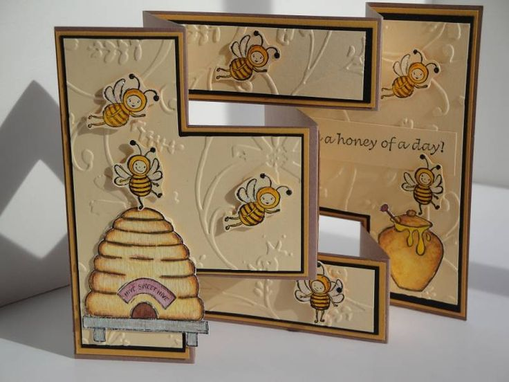 My try at a tri-fold card.  I stamped the hive and honey pot on watercolor paper and used watercolor wonder crayons.  The bees are stamped on barely banana cardstock and stickles on their wings then cut out.
