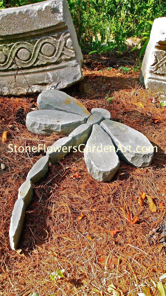 Mano del arte del jardín de flores de piedra astillada por dave450
