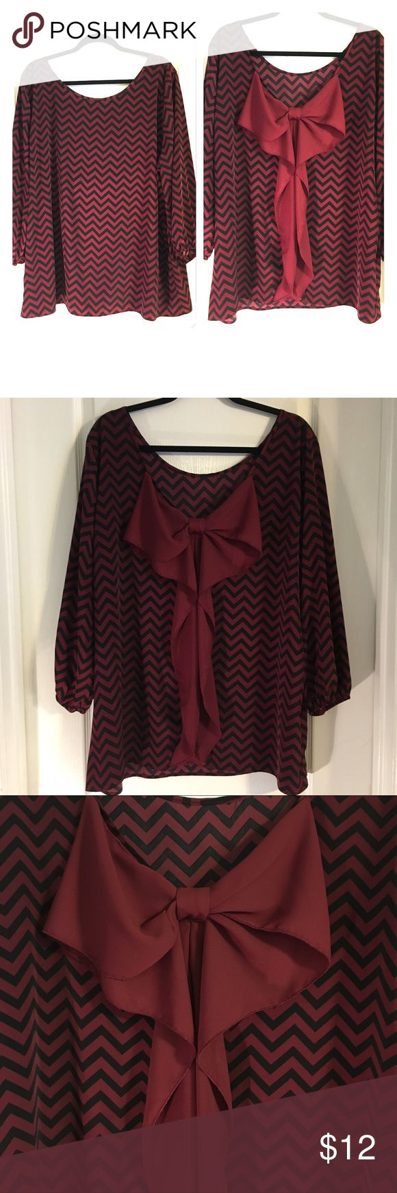 """Maroon & Black Chevron Print Boutique Blouse Giddy Up Glamour Boutique Brand ~ Plus Size Maroon & Black Chevron Print with Maroon Bow on the Back ~ Elastic on Sleeves ~ Shirt does not have Size tag but fits like a 2X ~ UA to UA is approximately 26"""" ~ Length from collar to hem is approximately 25"""" ~ EUC Giddy Up Glamour  Tops Blouses"""