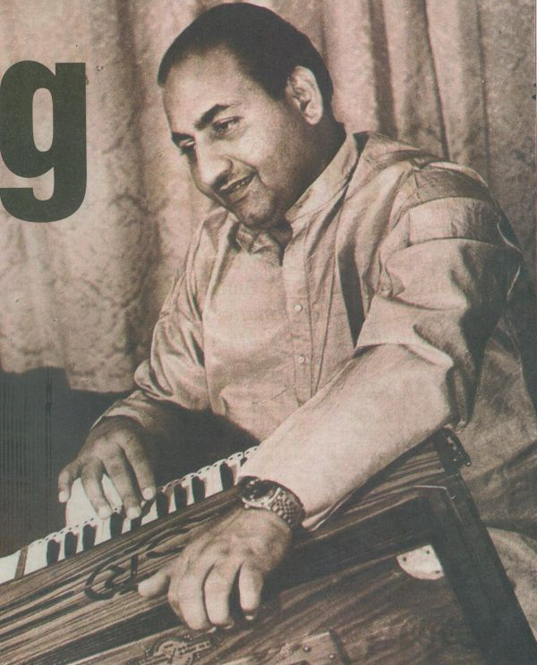 Mohammed Rafi (apparently he did play the harmonium)