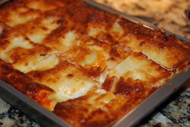 "Best Ever Lasagna: ""This is the best lasagna I have ever tasted. I love the mixture of ground beef and Italian sausage in the sauce. This dish is rich and cheesy as well."" -FruitLoop"