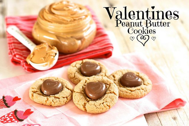 HANDS DOWN the BEST. Valentine's Peanut Butter Cookies!  Replacing the little Hershey's Kiss with a Dove Heart.