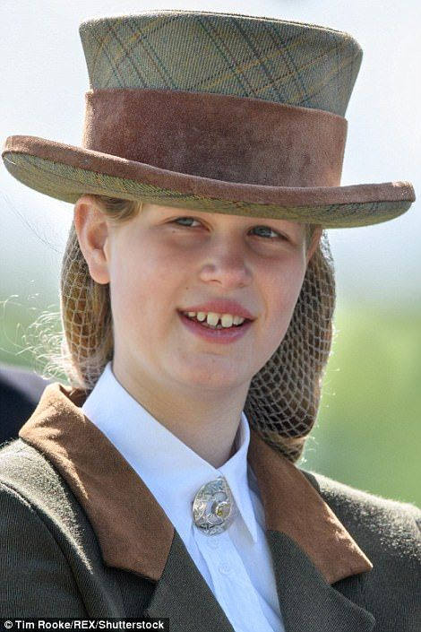 Lady Louise Windsor, 13, one of the youngest members of the royal family, looked perfectly at ease as she drove a carriage at the Royal Windsor Horse Show today.