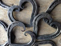 "Each of these horseshoes has been hand forged into a beautiful heart with curled ends. A wonderful way to celebrate an iron anniversary, wedding, sixth anniversary, or a great gift for that horse person in your life. This listing is for one heart. They are one of a kind and will be chosen at random. We are now offering this heart in two sizes due to customer requests. The pony shoe hearts measure approximately 3"" x 4"" and the standard horse shoe hearts measure about 4"" x 5"". Each has been…"