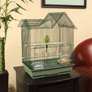 """Welcome your feathered friend home to the Green Ranch Style Bird  Aviary. This enclosure is absolutely ideal for your bird because of a variety of great features and a bird-friendly design. The aviary has sturdy wires are spaced at 1/2"""", perfect for keeping your pet safe and secure. This aviary includes two 1/2"""" dowel perches as well as two dishes for food and water."""