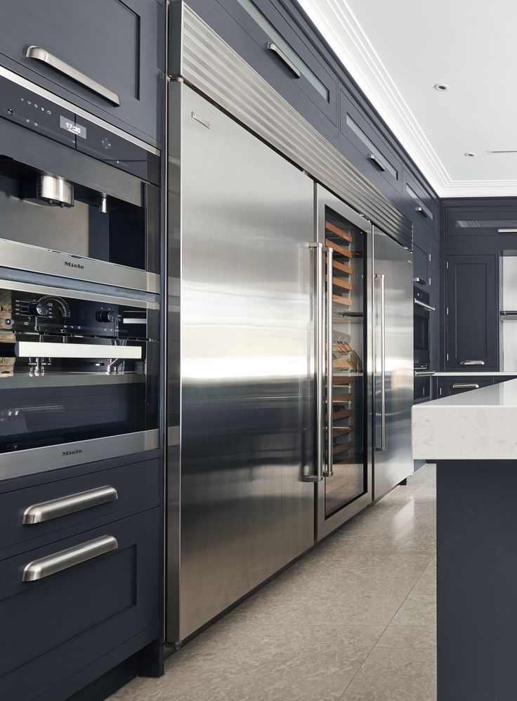 EXTREME Handcrafted luxury kitchen in private mansion. Handpainted kitchen in Farrow & Ball Railings. Featuring luxury Sub-Zero & Wolf appliances.