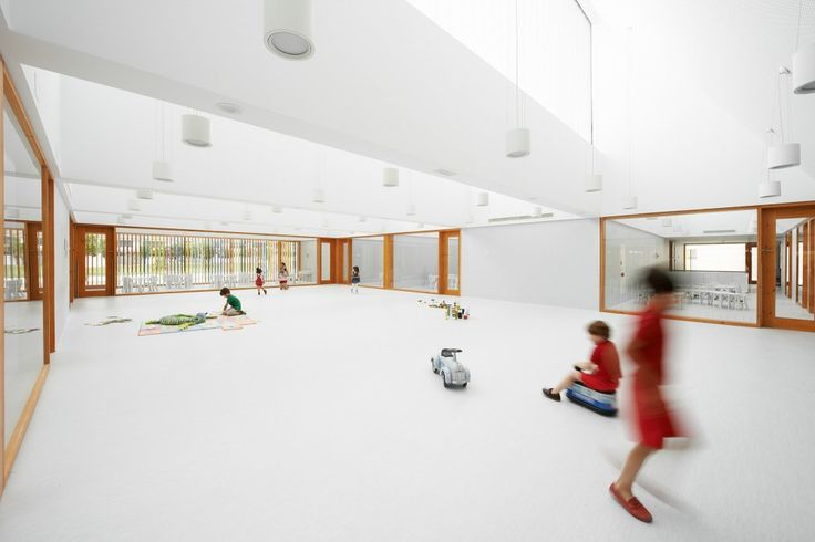 """The nursery was inspired by the Reggio philosophy of including a square or """"piazza"""" as a central point for gathering - with all spaces leading off it. Two outdoor courtyards are also arranged either side of it."""