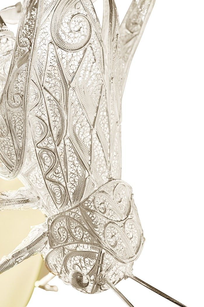 FILIGREE CRICKET SCONCES | Boca do Lobo perpetuates the craftsmanship tradition and creates a luxury handcrafted piece of art: a cricket figure entirely made of the most detailed silver filigree| www.bocadolobo.com #bocadolobo #luxuryfurniture #exclusivedesign #interiodesign #designideas #contemporary #gold #filigree #metamorphosis #contemporarydesign #lighting #walllam #lamp