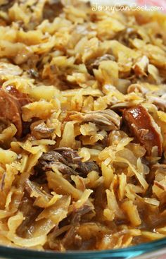 Polish Hunter's Stew (Bigos) recipe. Sauerkraut, cabbage, mushrooms, beef, and pork are slow cooked for 2 hours for a hearty pot of comfort food.