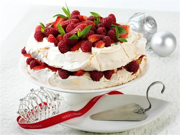 "pavlova cake- ""The Pavlova is an iconic dessert to New Zealand. The dessert was named after the prima ballerina Anna Pavlova, who toured New Zealand in 1926. It is rumoured that the Pavlova dessert was named in her honour by a Wellington chef. The light and fluffy Pavlova dessert is thought to represent the ballerina's famous swan costume which consisted of a white, layered tutu."""