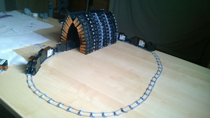 Train, tracks, and tunnel made from used ink cartridges.  It was made completely out of ink cartridges without any tape, glue or other materials used.
