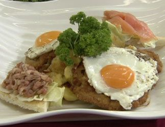 "Schnitzel Holstein - This old-fashioned fast food is one of several mean meal inventions made in Berlin. Schnitzel topped with egg sunny-side-up and garnished with salmon, sardines, capers and anchovies. Great for playing ""spot the schnitzel"" over your plate. (Or wherever else you throw this up. GACK!)  via Lidanoir"