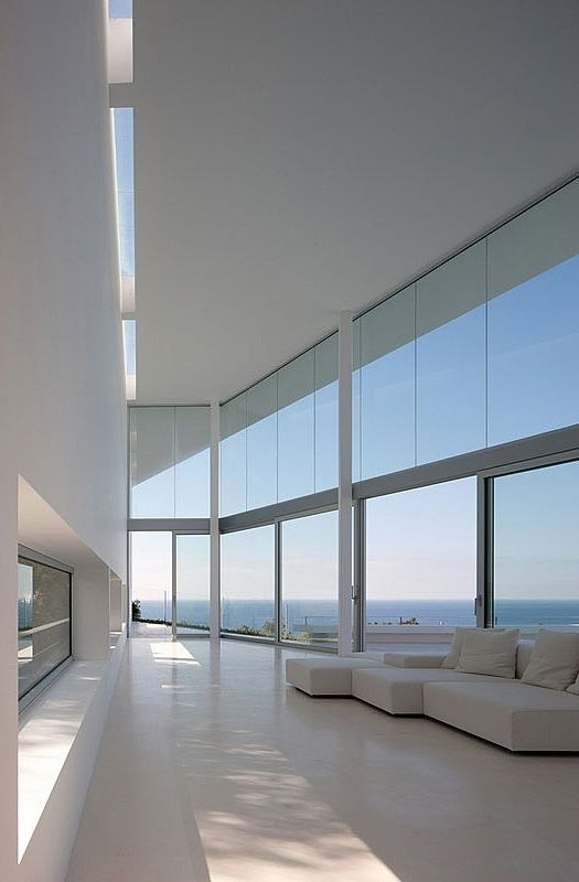 Interior with a view at Infinity House, Baleares, Spain by Atelier d'Architecture Bruno Erpicum & Partners
