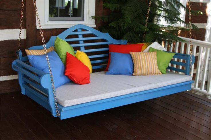 Love, Love, Love the blue painted swing bed and colorful throw pillows!