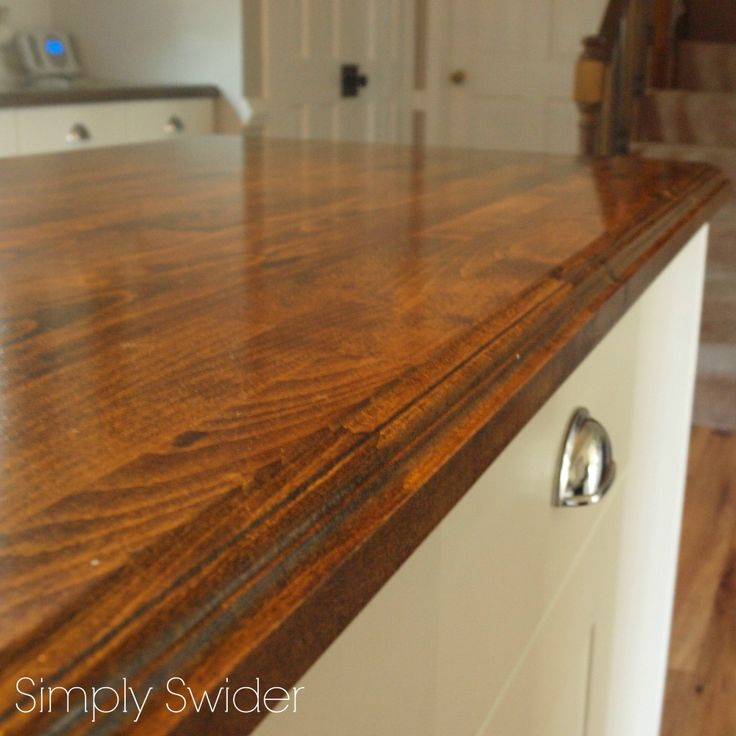 diy creating custom high end butcher block counter tops for cheap this is ikea butcher block they routed the edges stained and sealed