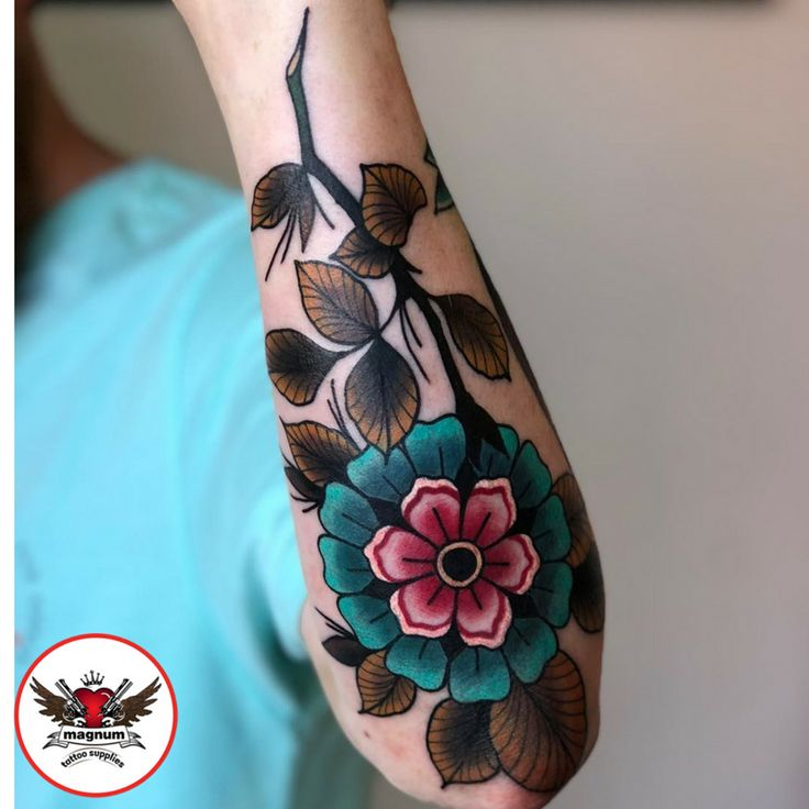 Autumn themed geo flower piece from Niall Shannon with #magnumtattoosupplies  #geoflower #autumn #colour #tattoo #ink