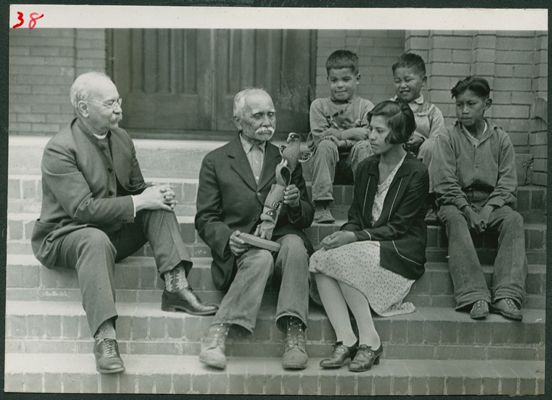 Principal George Raley, Chief William (K'HHalserten) Sepass, the chief's daughter, and some boys from Coqualeetza Industrial Institute, c. 1932. Raley was a collector and proponent of Aboriginal artwork and incorporated carving and basketry into the school curriculum. Sepass was chief of the Skowkale First Nation, in whose territory the school was located. UCCA, 86.229/5-38