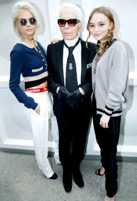 Model, actress and Victoria secret Angel Cara Delevingne in our JUNITA round black unisex sunglasses, by Sunday Somewhere. Whilst at a Chanel event in Paris. Also rocking Supreme. With Karl Lagerfeld and Lily-rose Depp