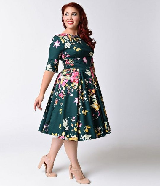 Made for a fabulous frolic! The Vintage Hepburn dress has arrived fresh from The Pretty Dress Company in a gorgeous hunter green and signature floral Seville print, cast in a classic retro dress design! Darling details include a chic high boat neckline wh