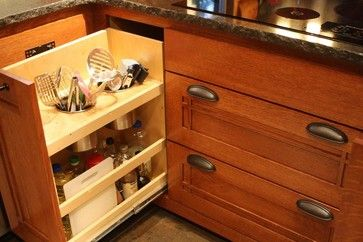 Would love to have various kitchen tools (spatulas, tongs, serving spoons, etc.) hidden in a cabinet but with easy access like this!