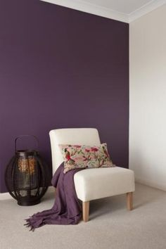 Aubergine wall for a cosy and warm bedroom feature wall.