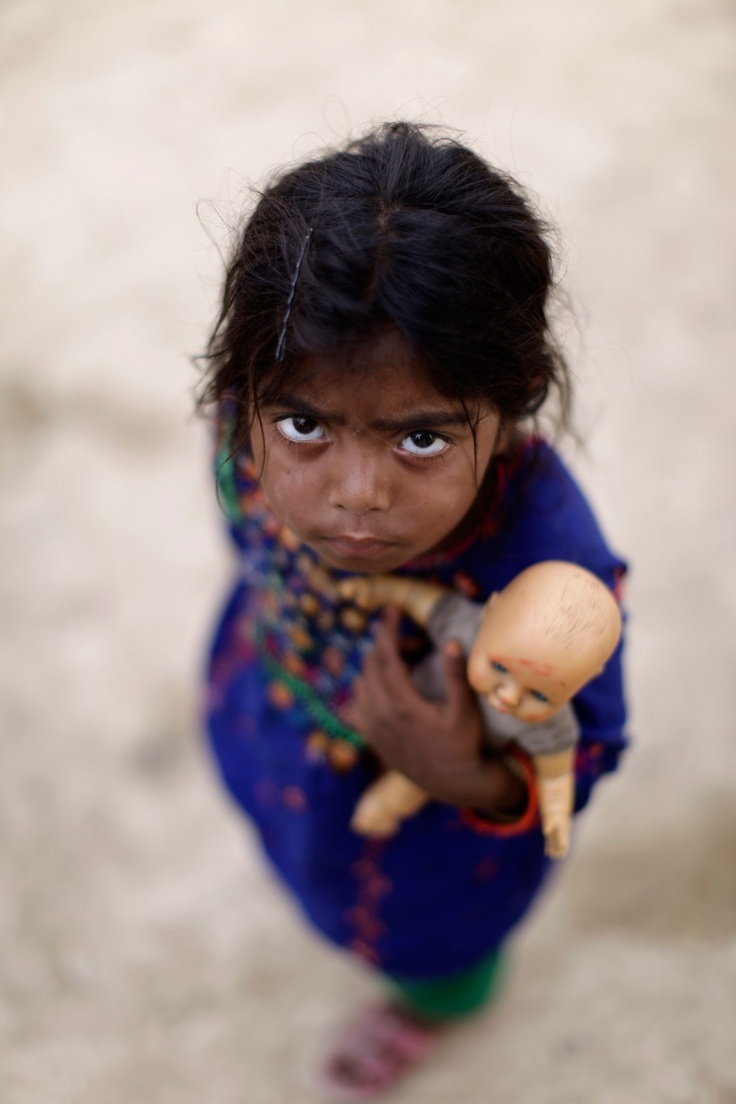 Pakistani girl Saima Hashim, 5, whose family was displaced by 2010 floods from a village in Pakistan's Sindh province, lives in a slum on the outskirts of Islamabad, Pakistan, June 18, 2012. (Muhammed Muheisen/Associated Press)