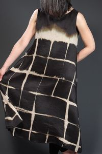 Linear Square Dress Description: Lined, sleeveless dress of silk bridal satin with surface design created using itajime shibori technique. All fabric is hand-dyed. Dimensions: H:48.00 x W:32.00 x D:0.00 Inches