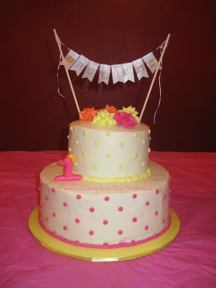 Ray of Sunshine 1st Birthday - Bright and Fun cinnamon swirl cake with cream cheese frosting.  Banner is edible rice paper with food color and pearl dust.  Will be making smaller replica smash cake for photo shoot next week too.