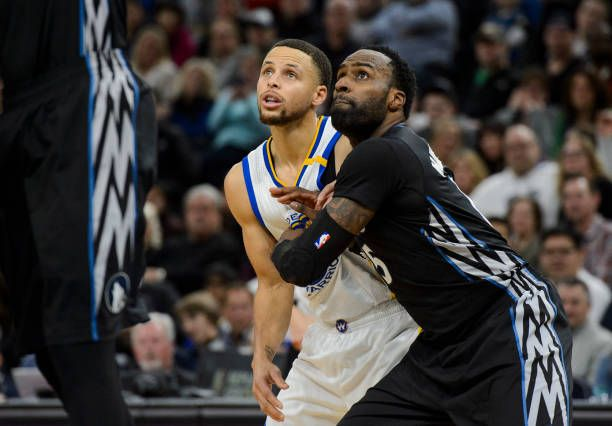 Shabazz Muhammad of the Minnesota Timberwolves boxes out Stephen Curry of the Golden State Warriors for freethrow during the fourth quarter of the...