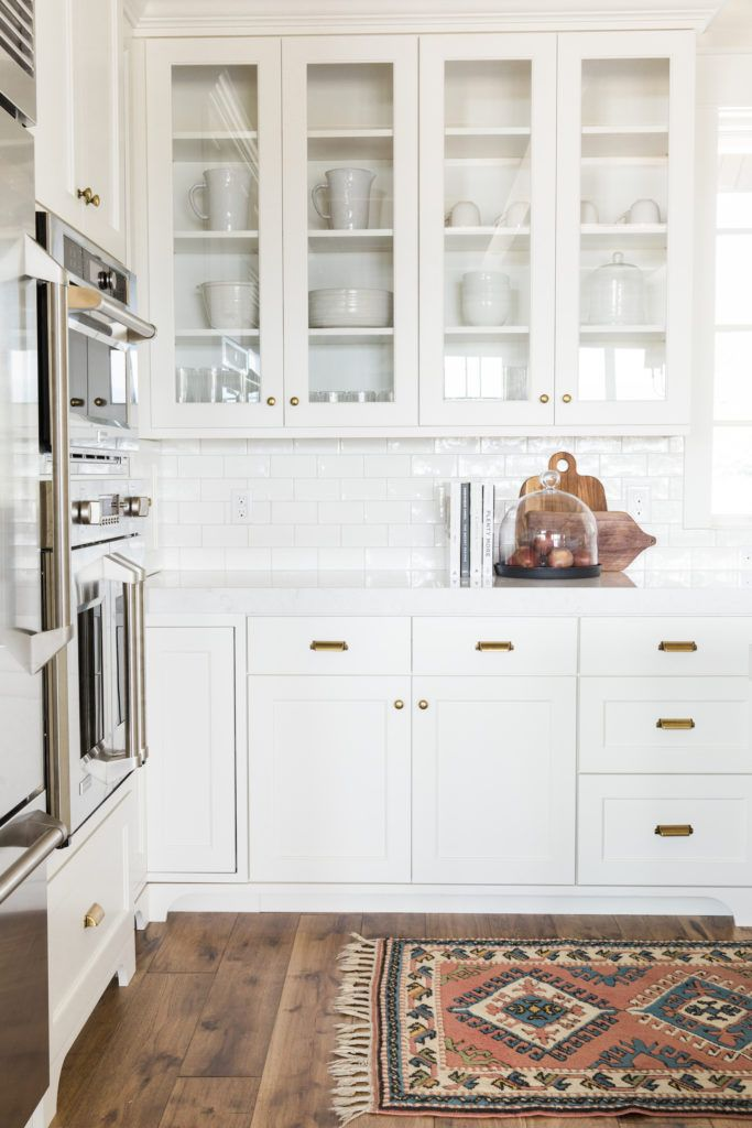 The next stop in our Midway New Build project is the kitchen and dining spaces! The kitchen is so calming and classic. We love the all white that is warmed up by the wood beams and floors. We brought in glass cabinetry, closed cabinetry and open shelving to break up all the storage. In the …