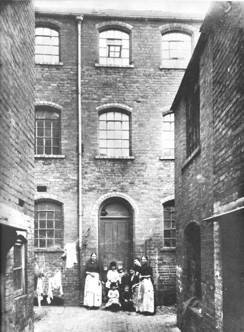 Slum, Birmingham, c. 1872; Broken windows, ragged clothes and narrow alleys. A typical Victorian slum.