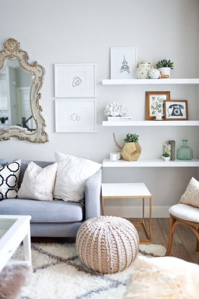 Hang floating shelves lower to add some interest to a room - love this decorating idea!