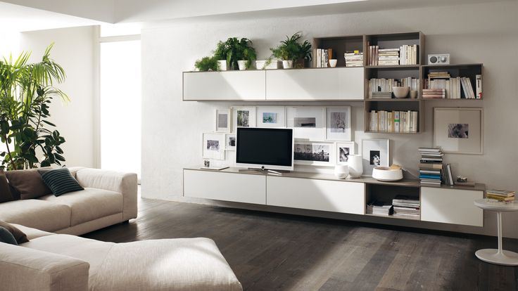 | Changing geometries in the #living area composition with suspended elements | #Scavolini |