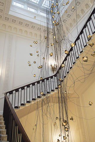 A 14-metre glass-and-metal chandelier, by B.C.-based Bocci, hangs above the Grand Staircase. #architecture #design #iadmagazine