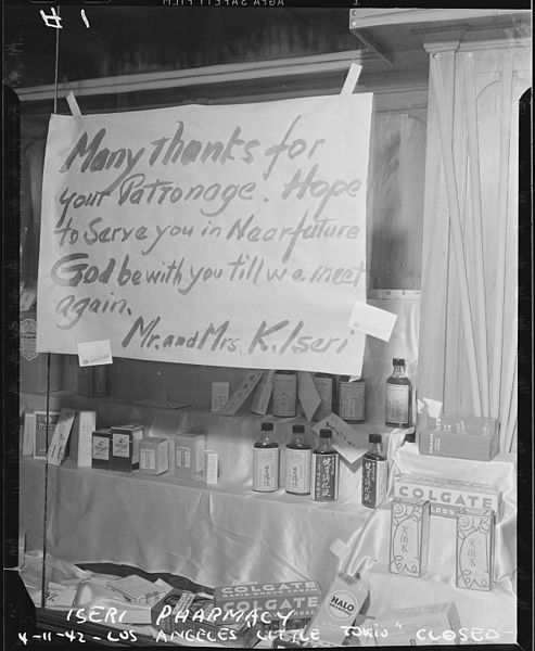 Mr. and Mrs K. Teri have closed their drugstore in preparation for the forthcoming evacuation of Little Tokyo, Los Angeles, California, 11 April 1942, Clem Albers, public domain via Wikimedia Commons.