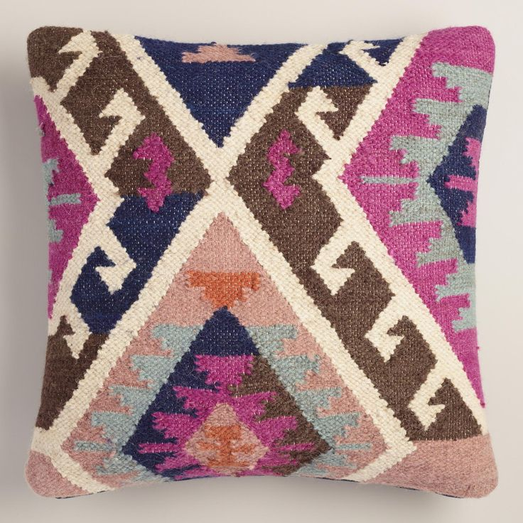 Crafted in India with a woven tapestry design and texture inspired by traditional kilim rugs, our wool and cotton throw pillow is a unique accent that extends the beauty of artisan floor coverings to your couch or favorite chair.