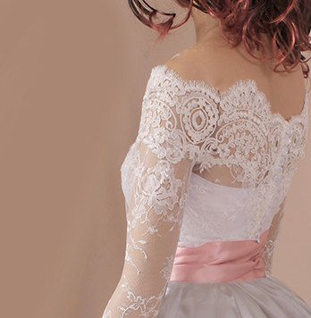 This is a beautiful off-shoulder wedding bolero made of lace with fine French lace trims. The color is available in ivory and white and black. It