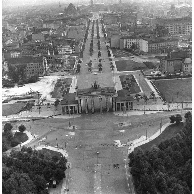 The Brandenburg Gate not long after Pagan arrives in Berlin. 26 August 1961: Two weeks after the East German government sealed off the Soviet-occupied sector, Berlin's former chief crossing point between East and West, the Brandenburg Gate, appears as no man's land, This is taken from the British sector of Berlin. Seen in the foreground is part of the city's park Tiergarten. Behind Brandenburg Gate proceeds the boulevard Unter den Linden, with parts of a newly erected cement barrier on the…