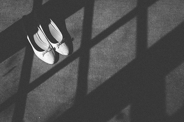 Bow and lace detailed Rainbow Club shoes sunbathing in the morning sunshine Photo by Benjamin Stuart Photography #weddingphotography #RainbowClub #BridalShoes #wedding