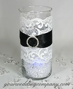 Cylinder vase with lace, ribbon, buckle, diamond confetti filler and blue LED light.