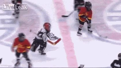 GIFBAY - Ref lends a hand to struggling little league hockey player - http://joronomo.com/funny-images/funny-gifs/gifbay-ref-lends-a-hand-to-struggling-little-league-hockey-player/
