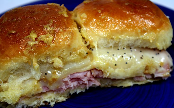 Hawaiian Ham Sandwiches  24 Hawaiian sweet rolls  1 lb deli ham, sliced thin  2 (6 oz) pkg shredded Swiss cheese ~ I used Swiss slices  1 tsp poppy seeds  1/2 cup butter  1 1/2 tbsp Dijon mustard  2 tbsps minced dried onion  1 1/2 tsps Worcestershire sauce @K D Eustaquio Grinnell