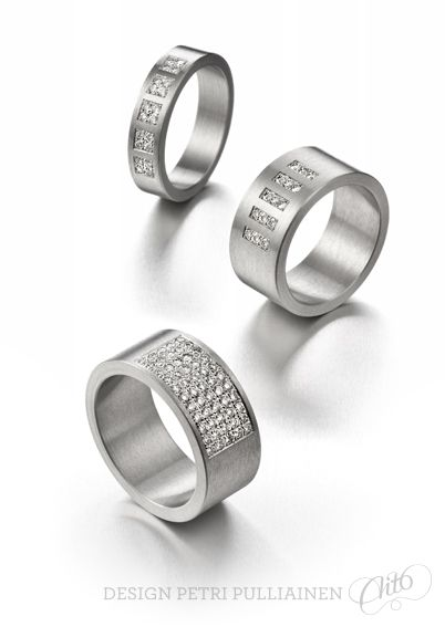 Stainless steel rings with diamonds.