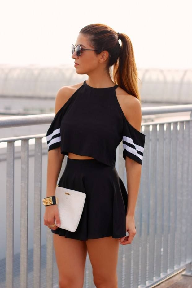 This look pulls together the sporty trend + still looking chic. The cold shoulders and the pinstripes on the sleeves pair well with the black mini skirt as a two-piece set.