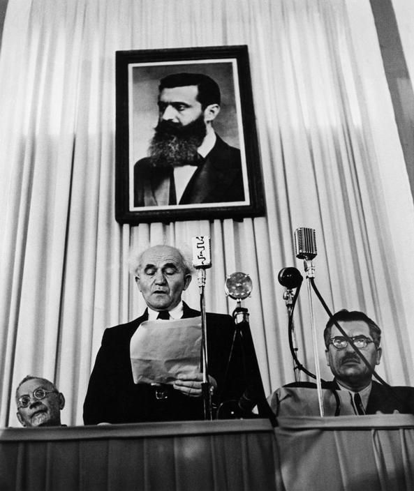 Robert Capa ISRAEL. Tel-Aviv. May 14th, 1948. Founder of the state of Israel, David Ben-Gurion reads the proclamation that will establish Israel as an independent nation.