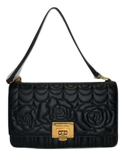 4f1aa8fc26f2a7 Get the trendiest Clutch of the season! The Michael Kors Vivianne Black  Flowers Leather Clutch is a top 10 member favorite on Tradesy.