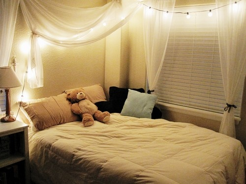 String lights over bed